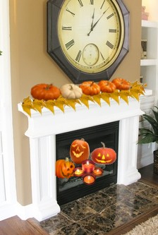 Carved pumpkins inside Fireplace and on the Mantle - Halloween Decorating Idea